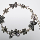 Butterflies and flowers silver tone personalised bracelet