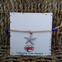 Silver coloured Starfish charm corded adjustable bracelet