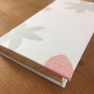Linen-bound hardback book in soft muted colours