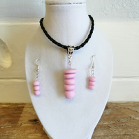 Faux leather necklace with pendant and earring set.