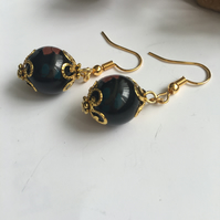 Black painted glass bead earrings with gold plated wires