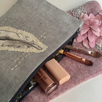 pretty grey linen make up bag embroidered with feather lined in liberty