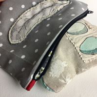 Grey polka dot feather embroidered make up bag lined in Liberty fabric