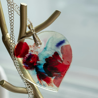 Heart shaped necklace. Resin and alcohol ink. Silver plated long chain.