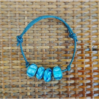 Blue Charm Bracelet - Round Blue Patterned Charms on Adjustable Waxed Cord