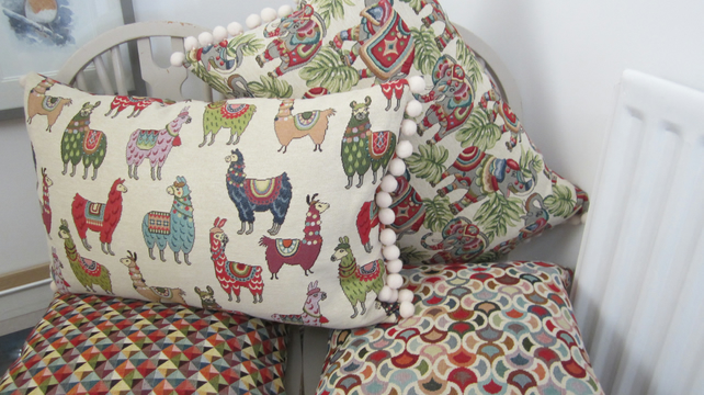 Tapestry Style Oblong Cushion with Pom Poms