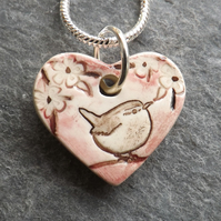 Heart shaped ceramic Wren in the Blackthorn pendant in pink
