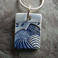 Tiny ceramic Mountains pendant in blue and white