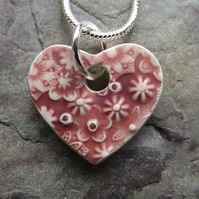 Heart shaped ceramic pendant in rose pink