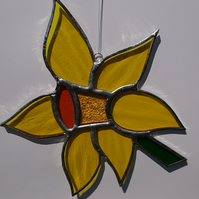Stained glass yellow daffodil flower. Suncatcher hanging decoration.
