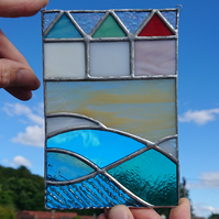 Stained glass three beach huts, beach and sea panel. Copperfoil hanging.