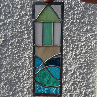 Stained glass single beach hut, beach and sea panel. Copperfoil and lead.