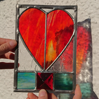 Stained glass ruby red heart hanging panel. Copperfoil and lead.