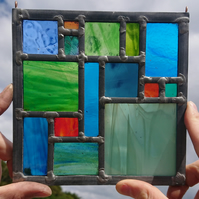 Stained glass geometric leaded panel - green, turquoise and orange.