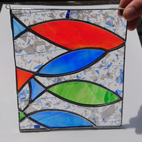 Stained glass blue, red, green fish hanging panel in copperfoil