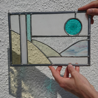 Stained glass abstract landscape, transparent glass panel. Copperfoil and lead.