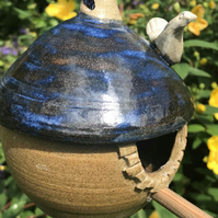 Hand thrown Bird Feeder with Blue Roof by Val Andrews