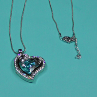 GLASS HEART LOCKET WITH CRYSTALS.