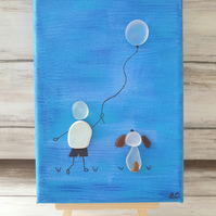 "Seaglass and seapottery canvas art ""BOY'S BEST FRIEND"""