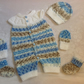 "BABY ROMPER HAT, BOOTIES MITTENS TO FIT 16"" HANDKNITTED IN VARIEGATED ACRYLIC"
