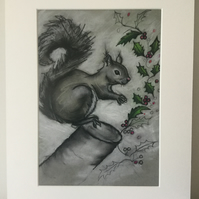 Mounted squirrel and holly print.