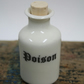 Small porcelain bottle with poison wording