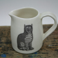 Porcelain jug with two cat images