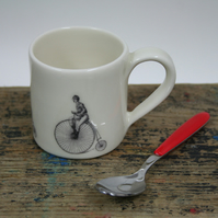 Small porcelain mug with penny farthing image