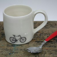 Small porcelain mug with bicycles