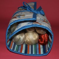 The Dolly Wrap. Holds six Barbies in little pockets & rolls up to carry with you
