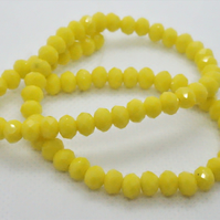 Opaque Yellow Faceted Rondelles (11-13)
