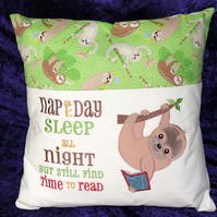 Embroidered sloth reading cushion