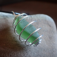 Frosted green sea glass pendant in silver plated cage, adjustable leather cord