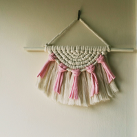 Small semi circular macrame wall hanging for a nursery or girls bedroom.