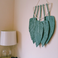 Macrame dream catcher with feathers in sage green