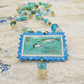Vintage Stamp Pendant on Glass Beaded Necklace