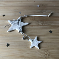 Handmade white porcelain star decoration with silver bells