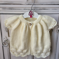 Baby girl's knitted cardigan