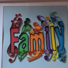 Colourful quilled picture in a deep box frame