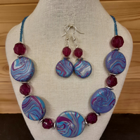 Handmade polymer clay disc-shaped necklace and earring set