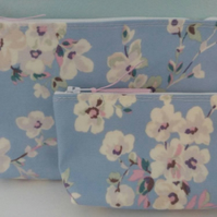 2 Makeup Bag made with oil cloth material Spring Blossom on light blue