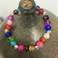 Multicoloured crackle glass beads bracelet with Tibetan metal spacers 17cm