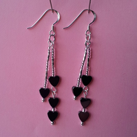 Hematite double drop earrings with Hematite hearts and silver beads.