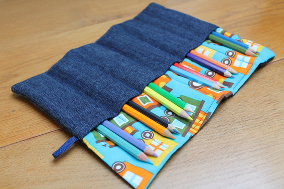 Quilted train print and denim pencil roll with 12 coloured pencils