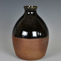 A wood-fired, stoneware bottle vase
