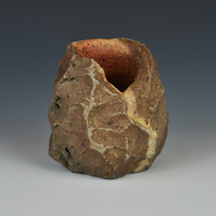 A carved, sake cup or guinomi