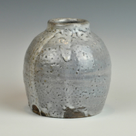A wood-fired, stoneware vase with shino glaze