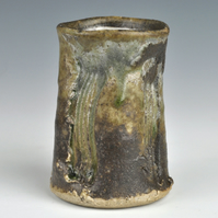 A stoneware vase with shino and ash glazes