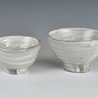 A stoneware sake and tea bowl set