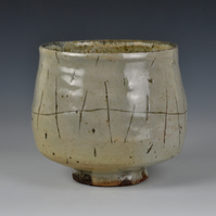 A large, wood-fired tea bowl with slip decoration
